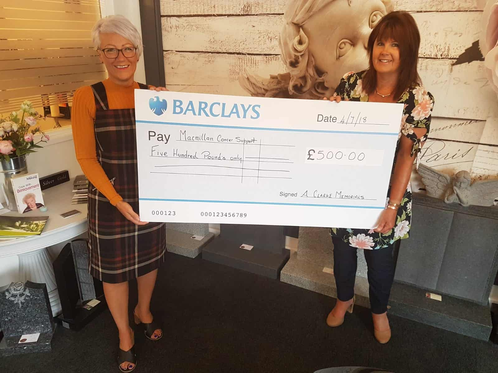 McMillan charity cheque